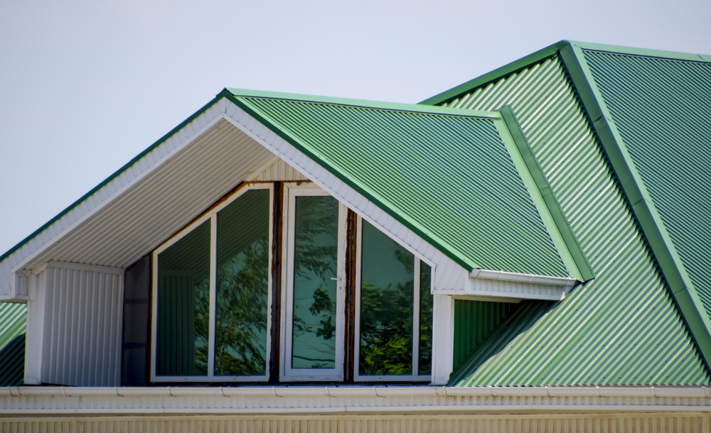 What are the pros and cons of metal and tile roofs?